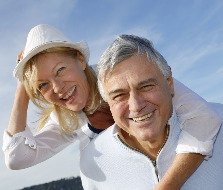Portrait of cheerful senior couple having fun at the beach-1-1